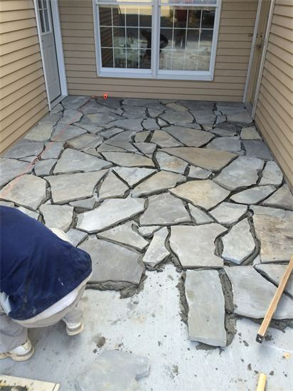 Stone walkway being worked on by Sturgeon Stone & Landscape