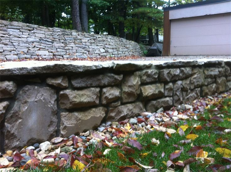 new stone retaining wall by driveway