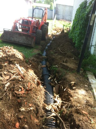 drainage pipe being installed by Sturgeon Stone & Landscape