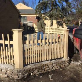 new vinyl fence by Sturgeon Stone & Landscape