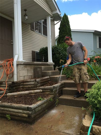 retaining walls and sidewalk being installed by Sturgeon Stone & Landscape