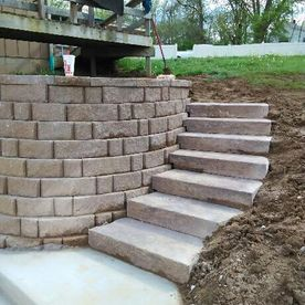 new retaining wall and walkway by Sturgeon Stone & Landscape